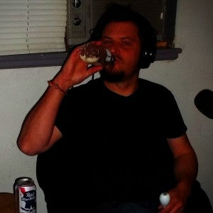 Jeremy Morrow of Merkin on The Worst Little Podcast, pretending to drink rice out of a water bottle shaker