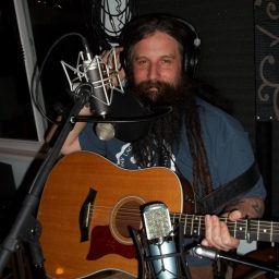 Josiah knight, cloaked in beard and guitar and microphones